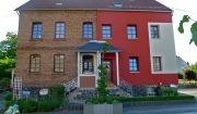 외단열 미장마감 공법(EIFS)으로 오른쪽 외벽을 덮은 독일의 주택