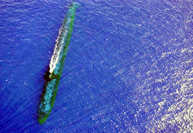 USS Chicago (SSN 721) at periscope depth off Malaysia