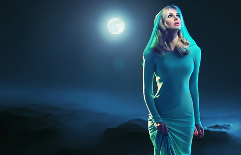 Women under the moonlight Stock Photo