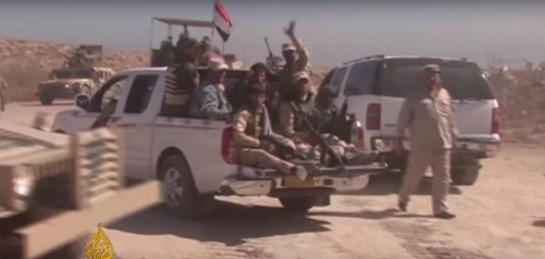 지난 23일(현지시간) 팔루자 수복작전에 나선 이라크 정부군과 시아파 민병대가 작전지역으로 이동하고 있다. |알자지라 방송 캡처