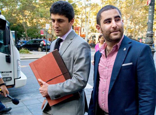 2014년 9월 유죄 판결을 받은 후 법정을 나서고 있는 슈렘.