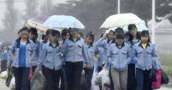 중국 기업에 고용된 북한 노동자 자료사진. [연합뉴스]