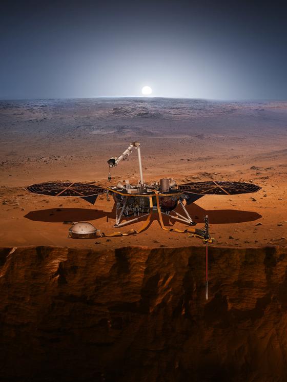 화성에 도착한 인사이트가 지표면을 뚫고 화성내부를 탐사하는 모습을 담은 조감도. 왼쪽 지표면 위로 둥그런 지진계측장비와 땅속 탐침장비 HP3(오른쪽)가 보인다. [사진 나사]