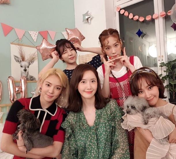 <p>Girls Generation-Oh! GG (o support) members Taeyeon, Sunny, Hyoyeon, Im Yoon-ah, the glass comeback certification photo was released.</p><p>Sunny said on September 6, If you like fun (todays name of the Girls Generation Official Fan Layers) on your own instruments, we are better! By the way, MC comes out like this, Twelve years have been broadcasted together.Why do you always unite to be a spirit? Why do not you have a small view? Shout out! Support Forever! Lets unite as soon as possible! Next post will be better than everyone in the face!  did.</p><p>Girls in the photo Generation-Oh! The members of GG were put in. Hyoyeon and the glass hug a companion dog in his chest, Im Yoon-ah sitting between the two boasts a refreshing smile. Sunny shows cute wink, Taeyeon is taking V pose. 5 members appear bright and dazzling.</p><p>Fans who touched the picture showed reactions such as cute, thank you for coming back, missed.</p><p>Girls Generation-Oh! GG announced the new song Lil Touch on the 5th, and made a comeback</p>