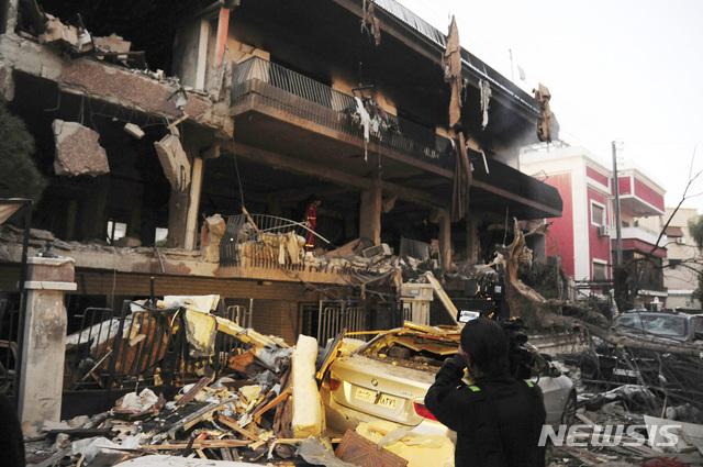 [AP/뉴시스] 지난해 이스라엘공군의  미사일 공습으로 파괴된 다마스쿠스의 아파트 . ( 시리아 국영 사나 통신 제공 사진 )
