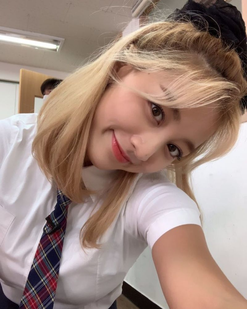 Group TWICE members JIHYO, Sana shared the current situation.TWICE Instagram posted several photos on September 15 with the caption, My high school mate.Jihyo and Sana in the photo wear school uniforms and smile adorablely.  The visuals of the two of them, who boast edgy chemistry in two shots, made their eyes happy.Meanwhile, JIHYO and Sanas group TWICE announced More & More on August 21.