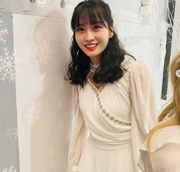 Group TWICE MOMO released her charm on her birthday (24).On the 9th, on TWICEs official Instagram, a photo of MOMO was uploaded with a happy birthday message saying My love, my friend, my eternal roommate, MOMO ring Happy Birthday!!!!!!The released photo shows a MOMO in a white dress reminiscent of the Greek Goddess. Another photo shows a cute MOMO with the head of the cartoon characterCandy and twinkling eyes.Accordingly, netizens celebrated MOMOs birthday with reactions such as Happy Birthday, I love you and Happy MOMO Day.Meanwhile, TWICE, which MOMO belongs to, was greatly loved by acting as a new songI CANT STOP ME.Photo|TWICE Official SNS