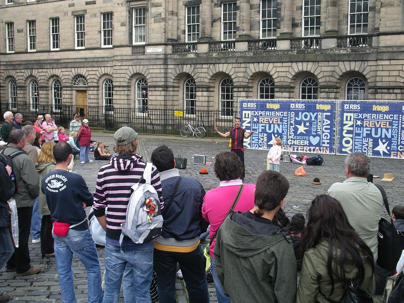 Street performance at a city square, Edinburgh, in Fringe Festival