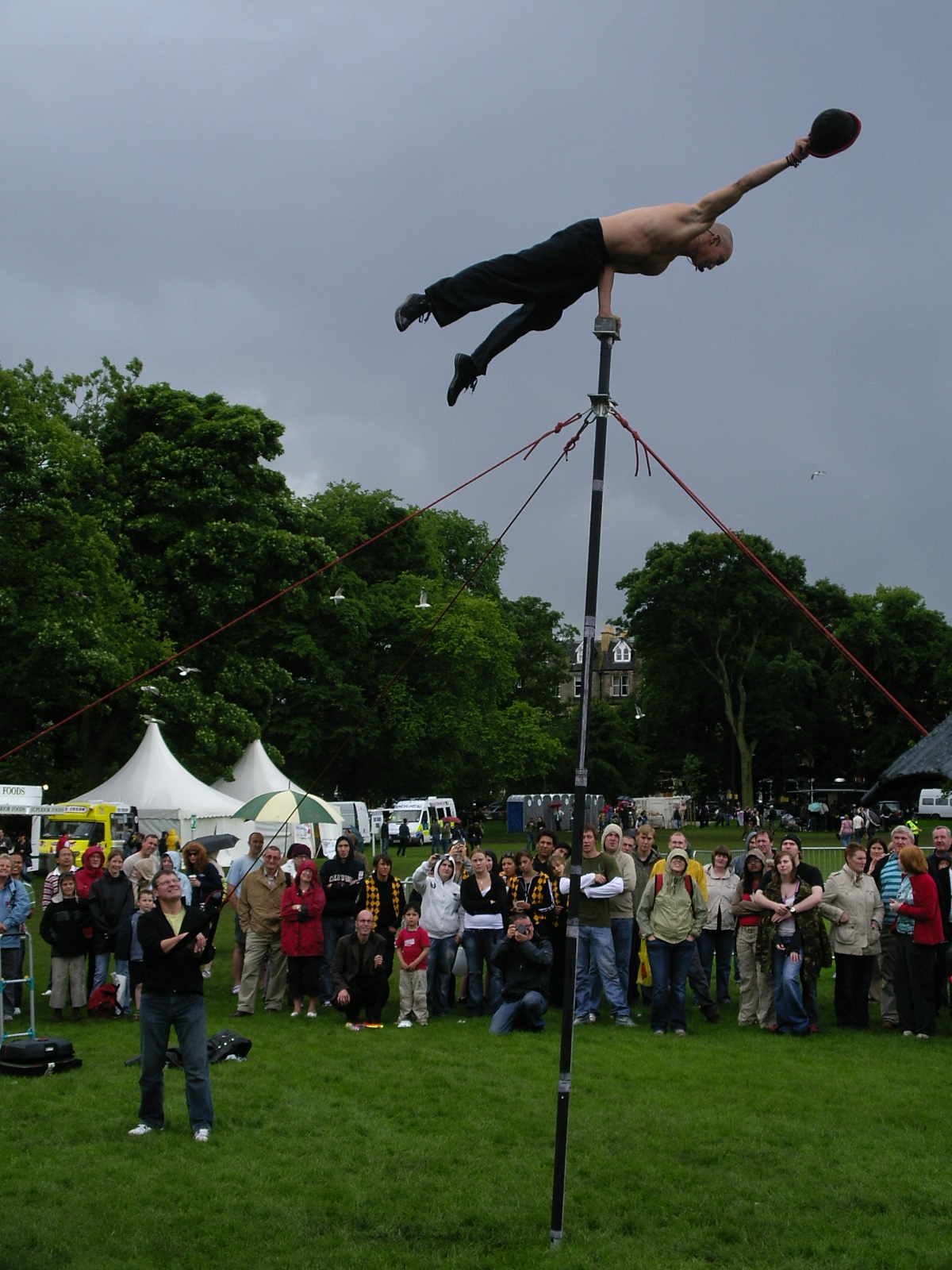 An acrobatic performer in the rain and sunlight (at the same time)
